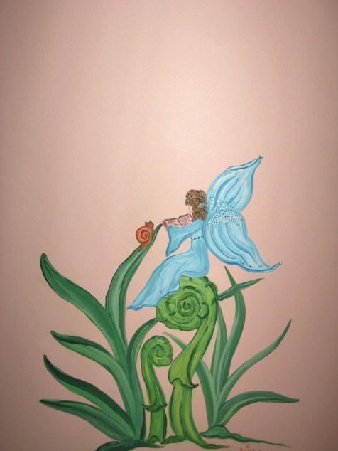 This fairy sit on a spring fern, reading to a snail.