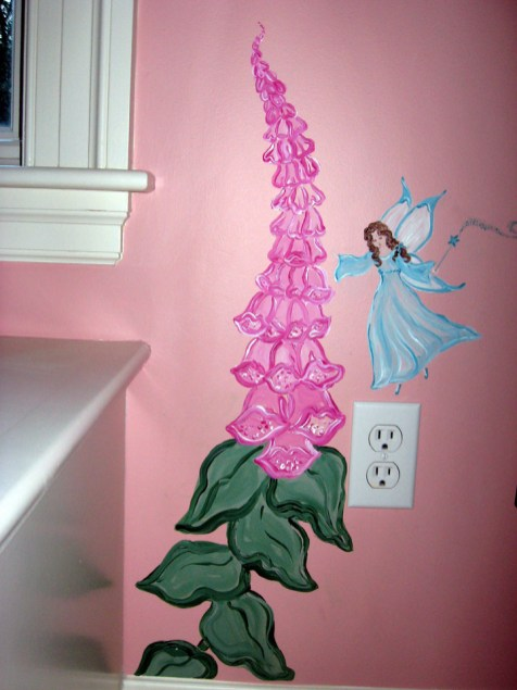 This fairy balances lightly next to a foxglove flower