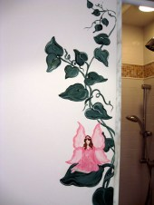 Here a fairy sits on a leaf of a vine hugging the entrance of a shower wall