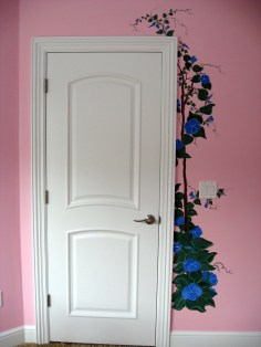 The edge of this nursery door is framed by a Morning Glory vine