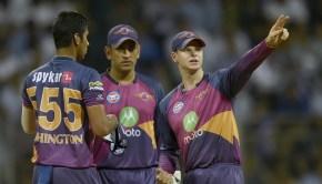 Rising Pune Supergiant cricketer Washington Sundar listens to Steven Smithas Mahendra Singh Dhoni