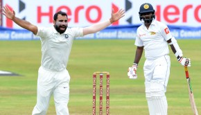 Mohammed Shami (L) unsuccessfully appeals for a Leg Before Wicket (LBW) decision against Sri Lankan cricketer Malinda Pushpakumara