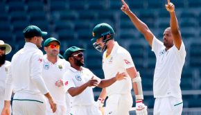South African bowler Vernon Philander (R) celebrates the dismissal of Australian batsman Pat Cummins