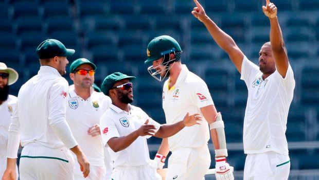South African bowler Vernon Philander (R) celebrates the dismissal of Australian batsman Pat Cummins
