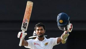 Dinesh Chandimal of Sri Lanka celebrates his century