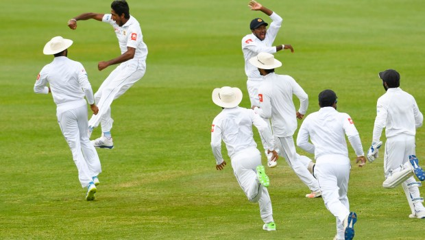 Kasun Rajitha of Sri Lanka celebrates the dismissal of Kieran Powell