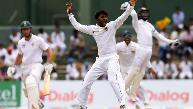 Sri Lankan cricketer Akila Dananjaya celebrates after he dismissed South Africa's Theunis de Bruyn