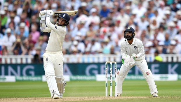 Sam Curran of England hits out for six runs watched India wicketkeeper Dinesh Karthik