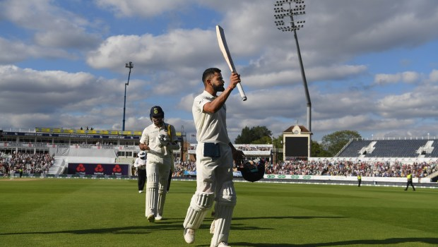 India batsman Virat Kohli leaves the field after his innings of 149