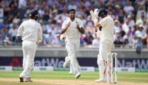 England batsman Joe Root reacts as India bowler Ravi Ashwin celebrates his wicket