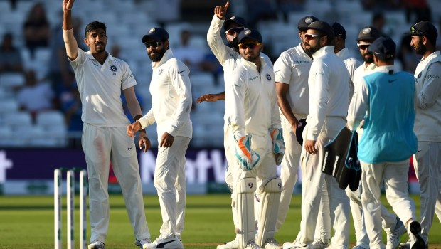 Jasprit Bumrah of India holds up the ball after taking a five wicket haul