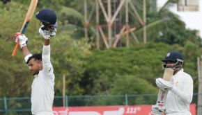 Karnataka's Mayank Aggrawal celebrates after completing his century during a Ranji trophy match