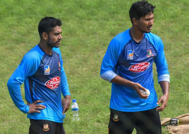 Bangladesh cricketers Mehidy Hasan (L) and Fazle Mahmud (R) attend a training session ahead of the first one day international (ODI) cricket match between Bangladesh and Zimbabwe at the Sher-e-Bangla National Cricket Stadium in Dhaka on October 20, 2018. (Photo by MUNIR UZ ZAMAN / AFP) (Photo credit should read MUNIR UZ ZAMAN/AFP/Getty Images)