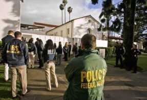 Federal agents outside the Bowers Museum in Santa Ana, CA