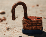 a rusty and trust padlock on a beach, looking after a business reputation