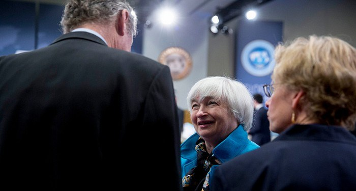 Janet Yellen, chair of the U.S. Federal Reserve, center, talks to Olivier Blanchard, chief economist of the International Monetary Fund (IMF), left, during the International Monetary Fund Committee (IMFC) governors plenary session at the International Monetary Committee (IMF) and World Bank Group Spring Meetings in Washington, D.C., U.S., on Saturday, April 18, 2015. IMF Managing Director Christine Lagarde warned this week that she wouldn't let Greece skip a debt payment to the lender, shutting down a potential avenue to buy the Greek government some financial leeway. Photographer: Andrew Harrer/Bloomberg via Getty Images