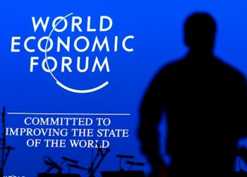 epa04569311 A worker during the last preparations inside the Congress Center, two days before the opening of the 45th Annual Meeting of the World Economic Forum, WEF, in Davos, Switzerland, 19 January 2015. The World Economic Forum unveiled the program for its Annual Meeting in Davos, including the key participants, themes and goals. The overarching theme of the meeting, which will take place from 21 to 24 January, is 'The New Global Context'.  EPA/LAURENT GILLIERON
