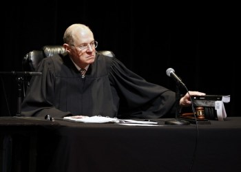 """January 31, 2011: U.S. Supreme Court Justice Anthony Kennedy presides over arguments at """"The Trial of Hamlet,"""" a Shakespeare Center of Los Angeles representation of Hamlet's trial with a jury of 12 community members, including actors, high school students, philanthropists and Los Angeles dignitaries at the University of Southern California Bovard Auditorium in Los Angeles on Monday, Jan. 31, 2011. (AP Photo/Damian Dovarganes)"""