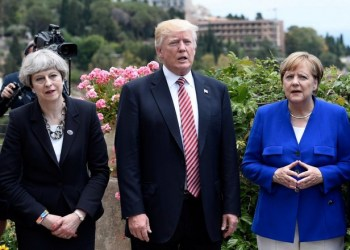 (L-R) Britain's Prime Minister Theresa May, US President Donald Trump and German Chancellor Angela Merkel arrive to watch an Italian flying squadron during the Summit of the Heads of State and of Government of the G7, the group of most industrialized economies, plus the European Union, on May 26, 2017 in Taormina, Sicily. The leaders of Britain, Canada, France, Germany, Japan, the US and Italy will be joined by representatives of the European Union and the International Monetary Fund (IMF) as well as teams from Ethiopia, Kenya, Niger, Nigeria and Tunisia during the summit from May 26 to 27, 2017. / AFP PHOTO / POOL / STEPHANE DE SAKUTINSTEPHANE DE SAKUTIN/AFP/Getty Images