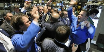 Traders crowd the post of Hercules Inc. at the closing bell on the floor of the New York Stock Exchange Thursday, Nov. 13, 2008. Wall Street has launched a massive rebound, sending the Dow Jones industrial average up about 550 points after driving it near its lows for the year. (AP Photo/Richard Drew)