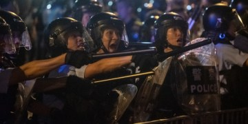 Riot police shout at protesters during clashes after a rally against a controversial extradition law proposal in Hong Kong on June 10, 2019. - Hong Kong witnessed its largest street protest in at least 15 years on June 9 as crowds massed against plans to allow extraditions to China, a proposal that has sparked a major backlash against the city's pro-Beijing leadership. (Photo by Philip FONG / AFP)