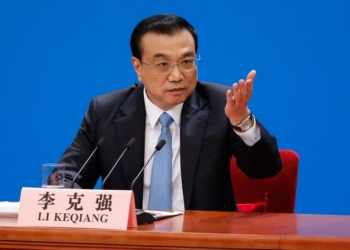 epa06615196 Chinese Premier Li Keqiang gestures as he speaks to reporters during press conference after the closing of the first session of the 13th National People's Congress (NPC) at the Great Hall of the People in Beijing, China, 20 March 2018. The NPC has over 3,000 delegates and is the world's largest parliament or legislative assembly though its function is largely as a formal seal of approval for the policies fixed by the leaders of the Chinese Communist Party. The NPC runs alongside the annual plenary meetings of the Chinese People's Political Consultative Conference (CPPCC), together known as 'Lianghui' or 'Two Meetings'.  EPA/ROMAN PILIPEY