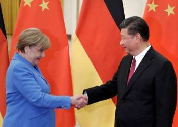 FILE PHOTO: China's President Xi Jinping meets German Chancellor Angela Merkel at the Great Hall of the People in Beijing, China, May 24, 2018. REUTERS/Jason Lee/File Photo