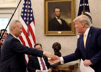 "President Trump shakes hands with Chinese Vice Premier Liu He at the White House after announcing a ""phase one"" trade agreement with China on Oct. 11, 2019. The two leaders are meeting again in Washington on Wednesday to sign the deal."