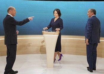 From left, Chancellor candidates Olaf Scholz (SPD), Annalena Baerbock (Green Party) and Armin Laschet (CDU) stand in the TV studio in Berlin, Sunday, Sept. 12, 2021. With two weeks left before Germany's national election, the three candidates for chancellorship are facing off Sunday in the second of three televised election debates. (Michael Kappeler/Pool via AP)