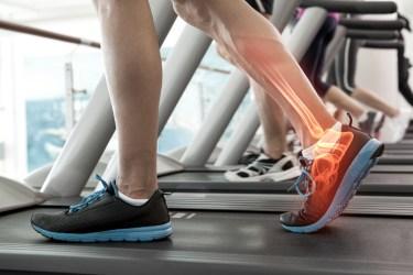 Digital composite of Highlighted bones of man on treadmill