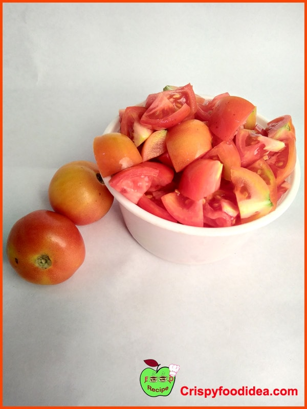 """Wash the tomatoes to cut into 1/2"""" pieces and keep in a bowl aside."""