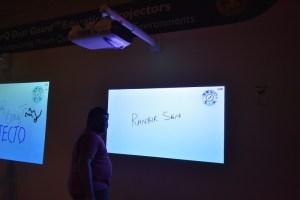 BenQ- Short throw projector, you use the screen for interactive purpose.