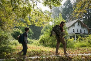 Left to right: Noah Jupe plays Marcus Abbott and John Krasinski plays Lee Abbott in A QUIET PLACE, from Paramount Pictures.