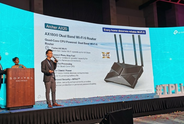 Ricky Li showcasing the features of the Tp_Link Archer AX20