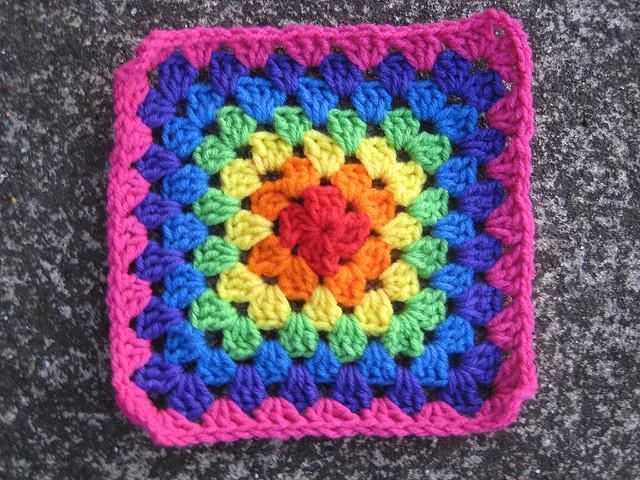 seven round multicolor crochet granny square
