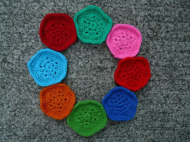 eight crochet pentagon motifs