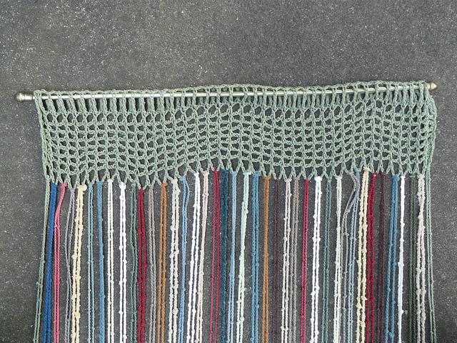 base of a crochet window covering