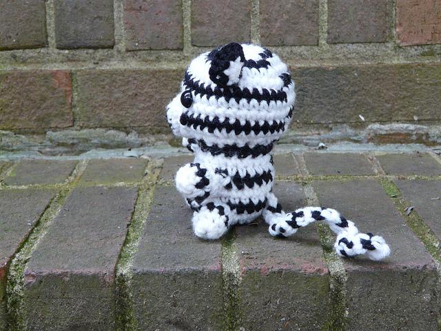 side view of white crochet tiger crochet amigurumi tiger