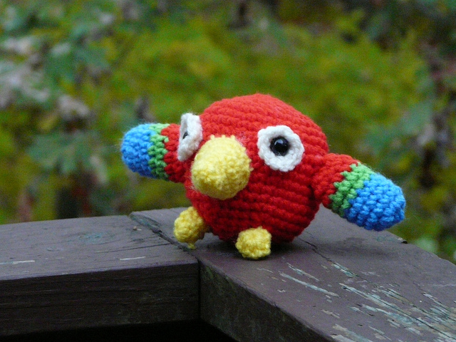 Perry the amigurumi crochet parrot prepares to fly