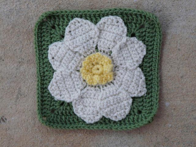 crochet square with a crochet flower center