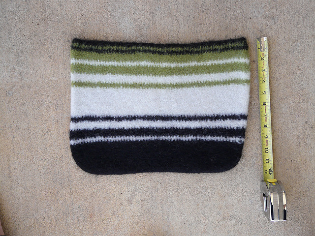A felted crochet wool bag measures twelve inches deep