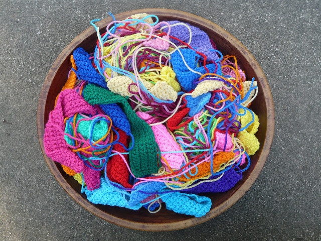 bowl full of crochet squares and rectangles