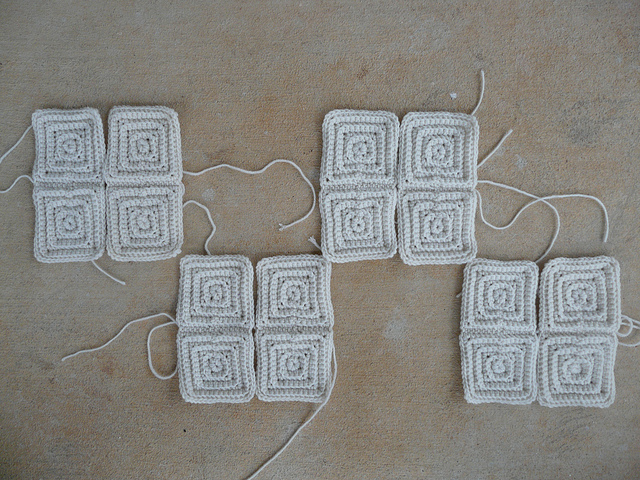 Sixteen small textured crochet squares