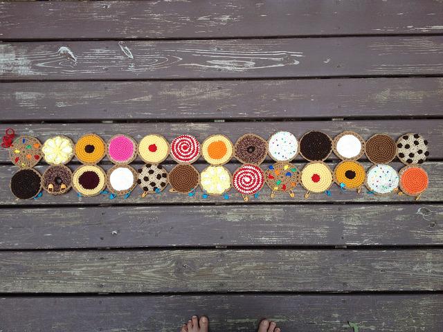 twenty-six crochet cookies