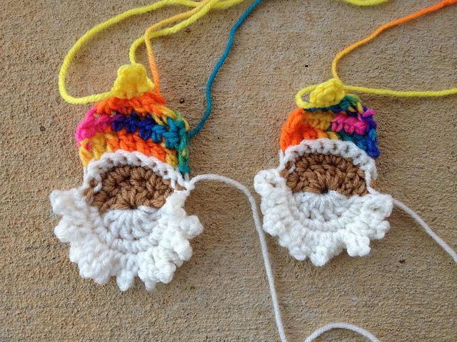 two crochet santa heads