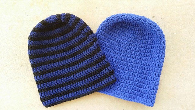 two blue slouchy crochet beanies