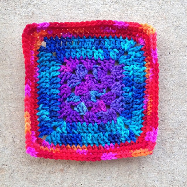 Crochet granny square made with three variegated yarns