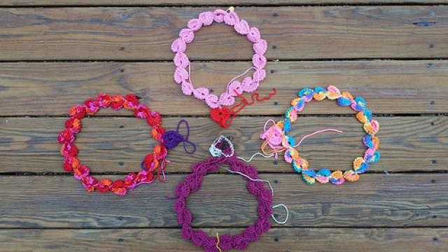 four crochet heart necklaces