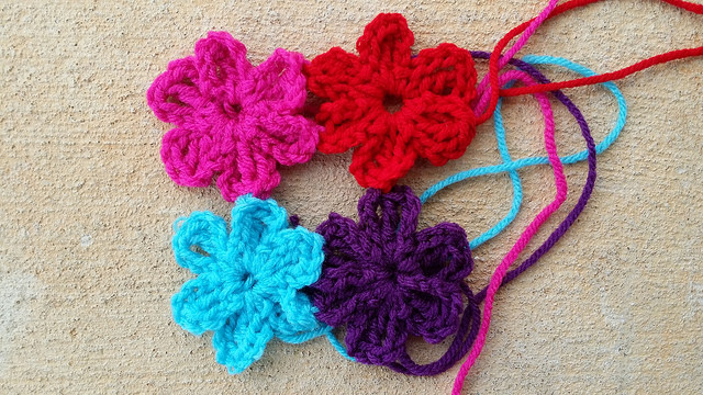 four crochet flowers