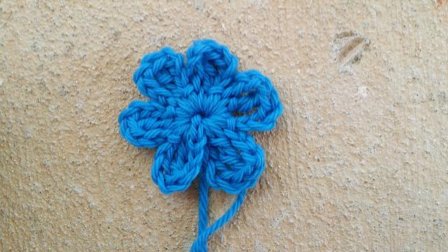 a blue crochet flower